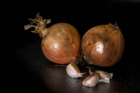 Onion and Fragrant garlic isolated with black background