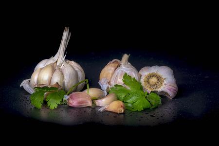 spiciness: fresh  garlic  isolated on Black background (onion) Stock Photo