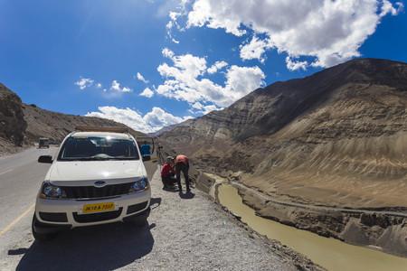 India 26 NOV 2017, Leh Ladakh, Unidentified people enjoy the scenery of beautiful mountain during journey to Lamayuru Sham Valley Leh India.
