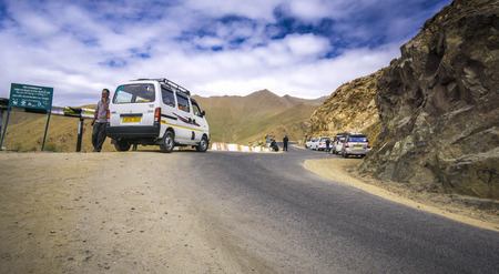 Ladakh, India - Nov 20, 2017. A tourist van parking on mountain road in Leh, Ladakh, India. Ladakh is one of the most sparsely populated regions in Jammu and Kashmir. Editorial