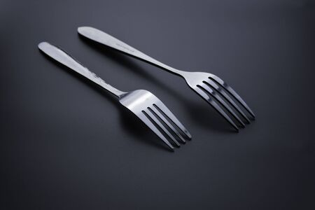 Fork and spoon on dark background, Restaurant concept. soft focus in the middle. Stok Fotoğraf - 131315360