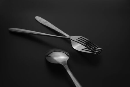 Fork and spoon on dark background, Restaurant concept. soft focus in the middle. Stok Fotoğraf - 131315262
