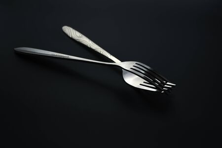 Fork and spoon on dark background, Restaurant concept. soft focus in the middle. Stok Fotoğraf