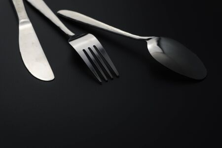 Fork and spoon on dark background, Restaurant concept. soft focus in the middle. Stok Fotoğraf - 131314492