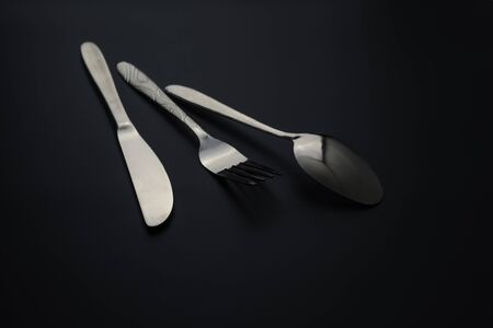 Fork and spoon on dark background, Restaurant concept. soft focus in the middle. Stok Fotoğraf - 131314854