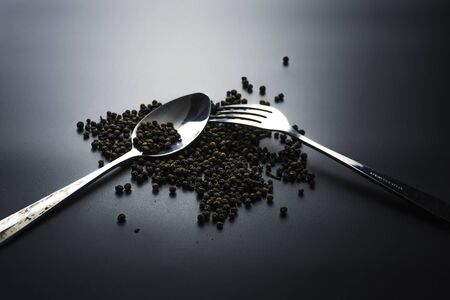 Fork and spoon on dark background, Restaurant concept. soft focus in the middle. Stok Fotoğraf - 131679115