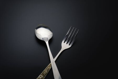 Fork and spoon on dark background, Restaurant concept. soft focus in the middle. Фото со стока