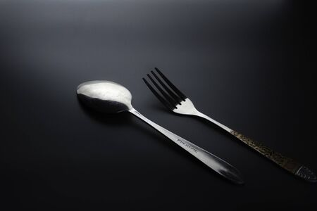 Fork and spoon on dark background, Restaurant concept. soft focus in the middle. Stok Fotoğraf - 131315966