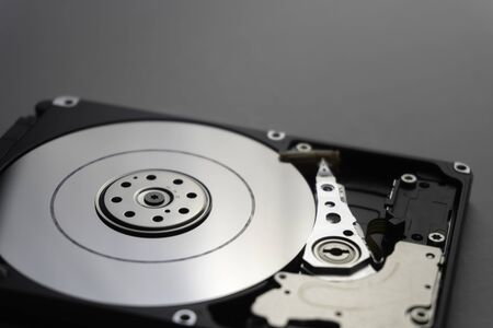 Close up of hard disk's internal mechanism hardware. Soft focus at middle and background. Stockfoto - 132272842