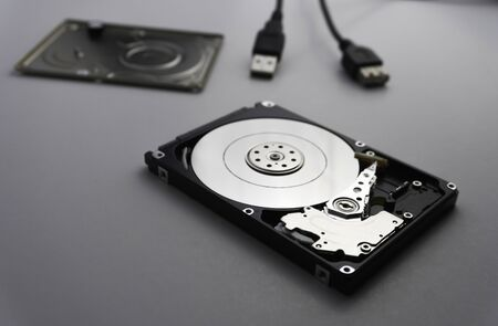 Close up of hard disk's internal mechanism hardware. Soft focus at middle and background. 写真素材 - 132041238