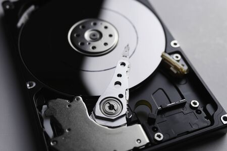 Close up of hard disk's internal mechanism hardware. Soft focus at middle and background. 写真素材 - 132040373