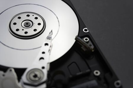 Close up of hard disk's internal mechanism hardware. Soft focus at middle and background. Stockfoto - 132040333