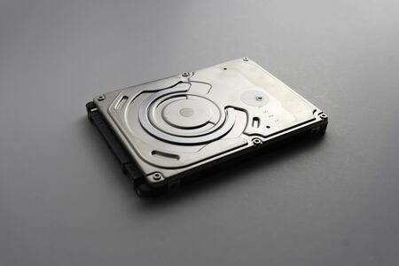 Close up of hard disk's internal mechanism hardware. Soft focus at middle and background. Stockfoto - 132237641