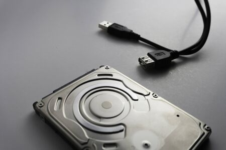 Close up of hard disks internal mechanism hardware. Soft focus at middle and background.