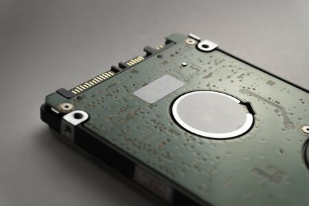 Close up of hard disk's internal mechanism hardware. Soft focus at middle and background. Stockfoto - 132236794