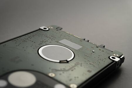 Close up of hard disk's internal mechanism hardware. Soft focus at middle and background.