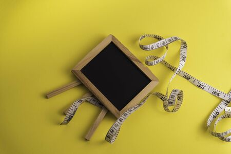 Black Board with a measuring tape, diet or healthy eating concept Stockfoto
