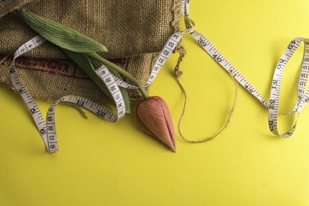 Flower  with a measuring tape, diet or healthy eating concept Stockfoto
