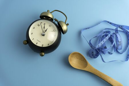 Time and measuring tape, diet or healthy eating concept. Stockfoto