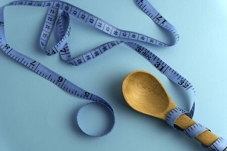 Measuring tape, diet or healthy eating concept.