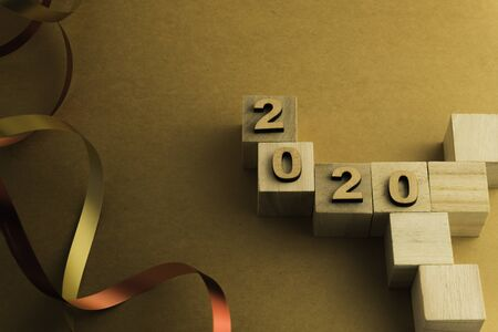 Happy New Year 2020. Symbol from number 2020 on brown background