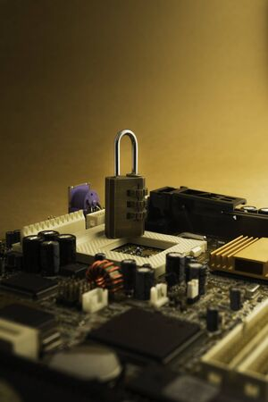 Padlock on PC Mainboard symbolizing Computer Cyber Security Concept. 版權商用圖片