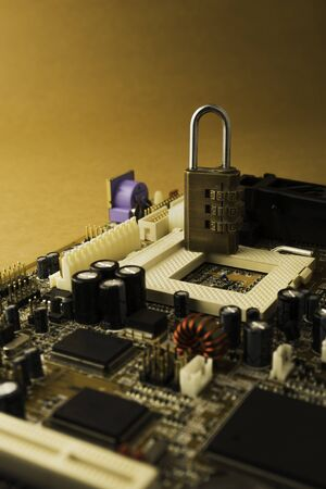Padlock on PC Mainboard symbolizing Computer Cyber Security Concept. Stockfoto