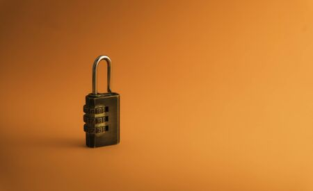 Combination padlock isolated on orange background. Business to success concept. Stockfoto