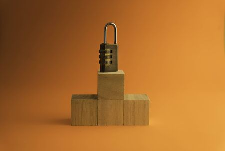 Combination padlock  isolated on orange background. Business to success concept.