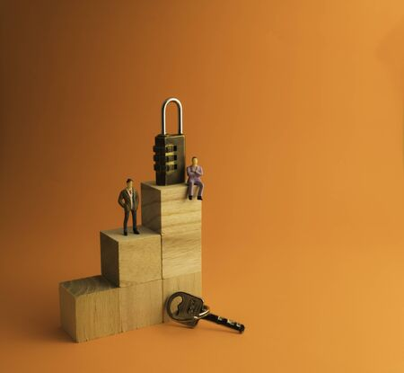 Combination padlock and key isolated on orange background. Business to success concept. Stockfoto
