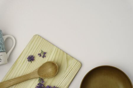 Empty wooden bowl, fork, spoon, cutting board, top view, background, template, food display montage, free space for text