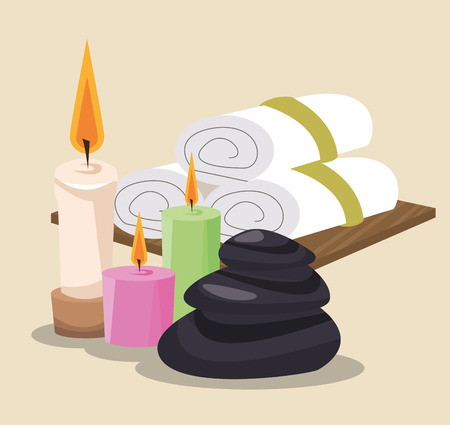 spa stones colored candles and towel