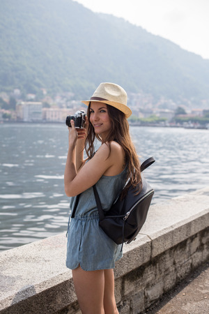 Attractive girl taking photos, girl travelling, summer day Stock Photo
