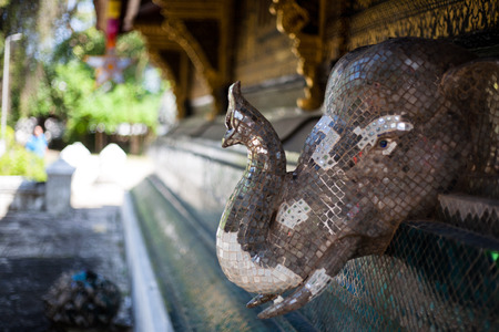 elephant figure on the wall of asian temple