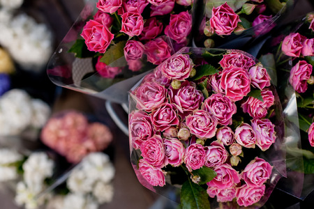 Beautiful pink rose bouquets for sale on street market upper view Stock Photo