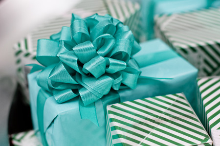 Beautiful present blue package with a big bow