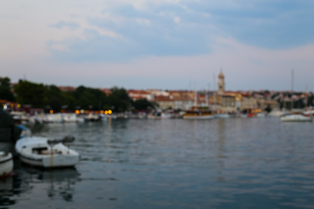 Mediterranean southern town in dusk, blur with bokeh light Stock Photo