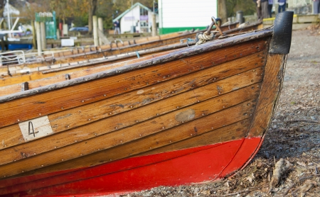 Small wooden rowing boats at Lake Windermere, Cumbria, United Kingdome in afternoon light photo