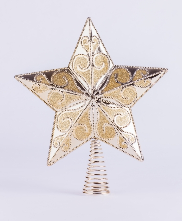 Patterned gold star on spring Christmas tree topper decoration isolated on white background Stock Photo - 20327663