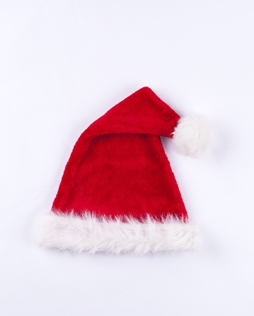 Folded top red and white Santa hat fluffy Christmas hat isolated on white background.