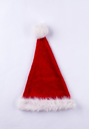 Red and white Santa hat fluffy Christmas hat isolated on white background. Stock Photo