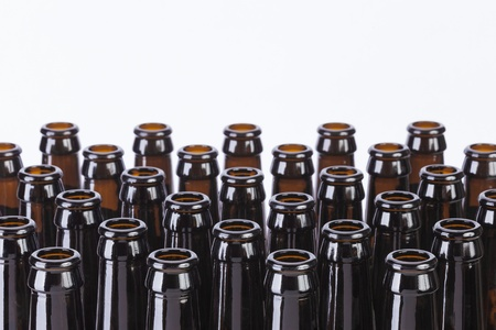 Brown glass beer bottles still life on white background with copy space