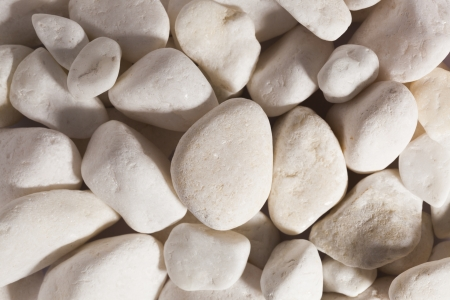 Close up of cream pebbles with hard lighting effect Stock Photo