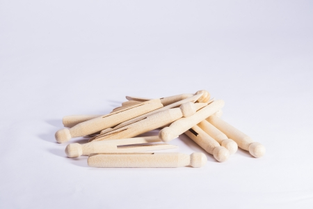 Wooden dolly pegs on white background Stock Photo - 20452544