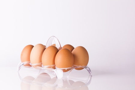 cooking ingredients eggs in clear plastic basket Stock Photo