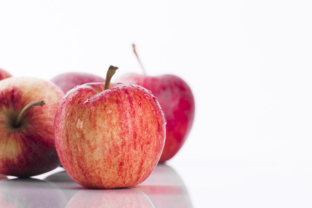 Juicy red apples on white background promoting healthy eating and lifestyle choices