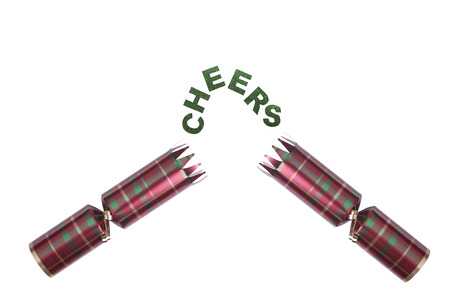 Isolated Christmas Cracker in tartan pattern with cheers in glittery text Stock Photo - 23989645