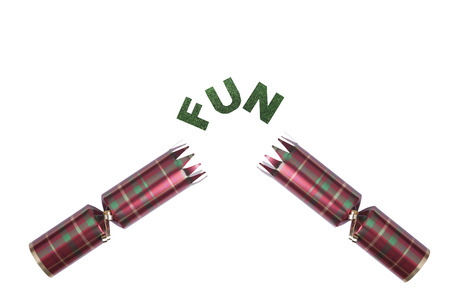 Isolated Christmas Cracker in tartan pattern with give in glittery text Stock Photo - 23989646