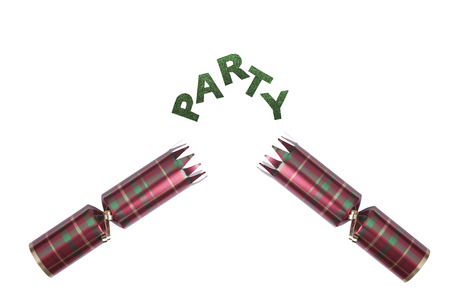 Isolated Christmas Cracker in tartan pattern with party in glittery text photo