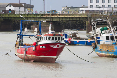 livelihoods: Fishing boats in Folkestone Harbour at low tide representing local industry Editorial
